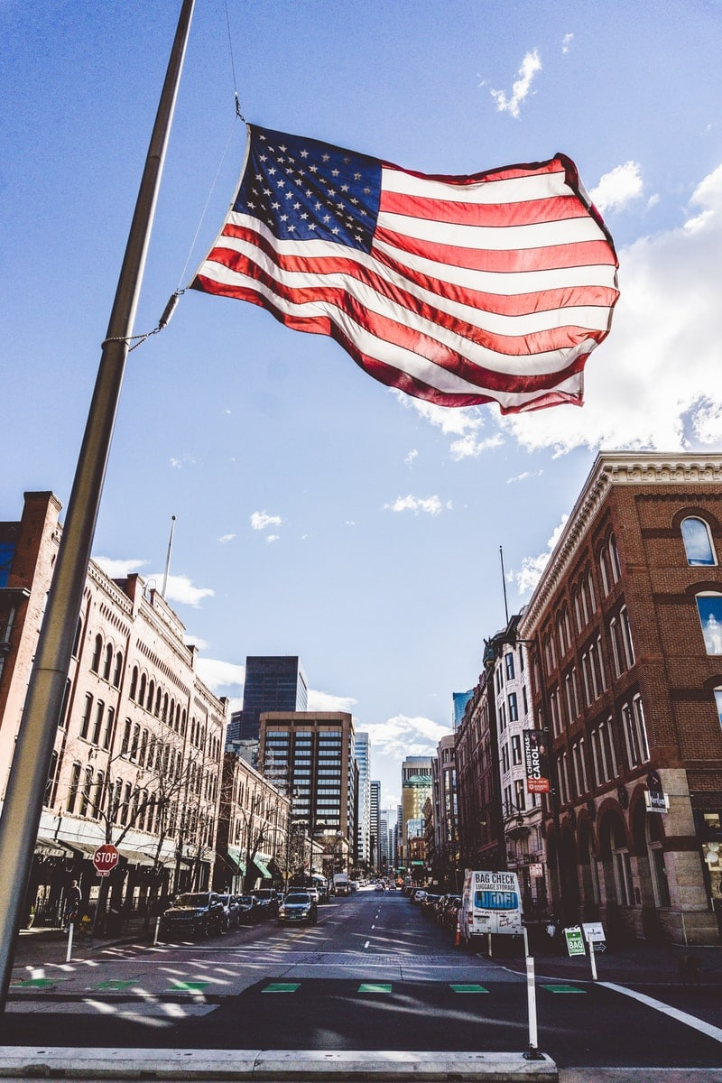 waving flag of United States of America during daytime