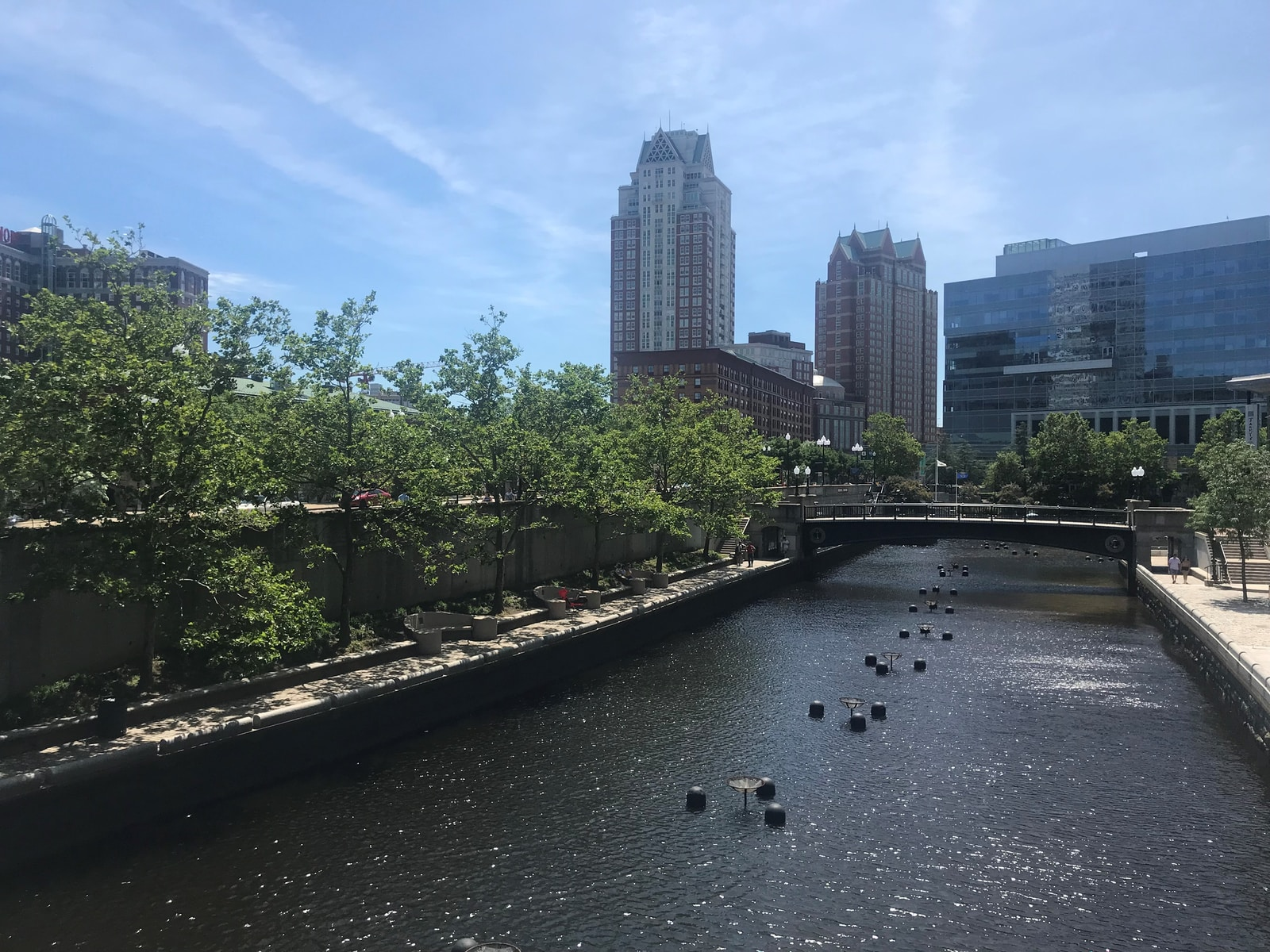 body of water near high-rise buildings